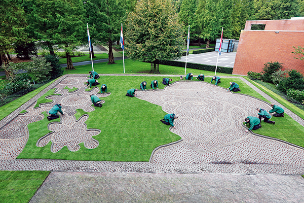 Tulip bulbs being delicately planted for the Van Gogh mosaic at Keukenhof