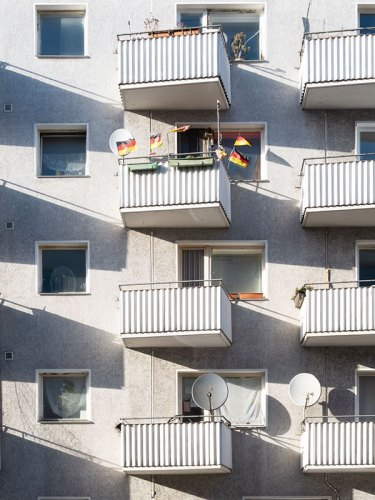A single apartment building with German flags