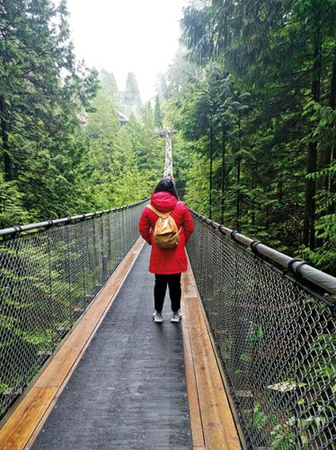 Crossing the Capilano Suspension Bridge in Vancouver