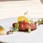 Assam tea lacquered duck with pomello and coconut chutney by Chef Ajay Chopra