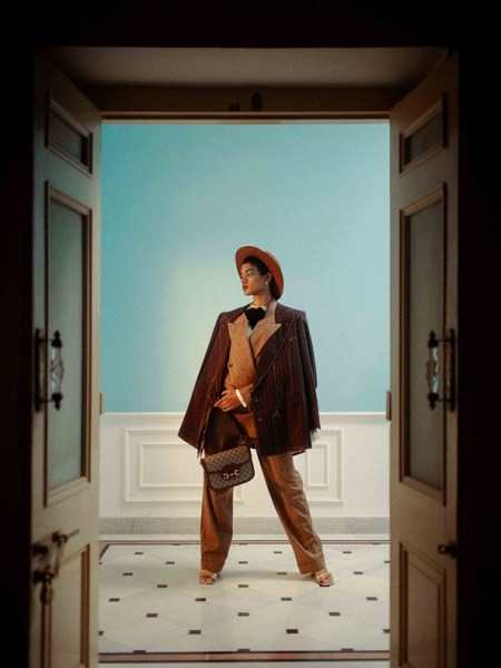 Retro GG wool jacket with lapels, poplin shirt, velvet brow, Retro GG wool pants with ankle tie, Gucci 1955 Horsebit shoulder bag, all from Gucci; brown leather hat, stylist's own.
