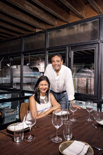 Gauri Devidayal and Jay Yousuf in the dining room