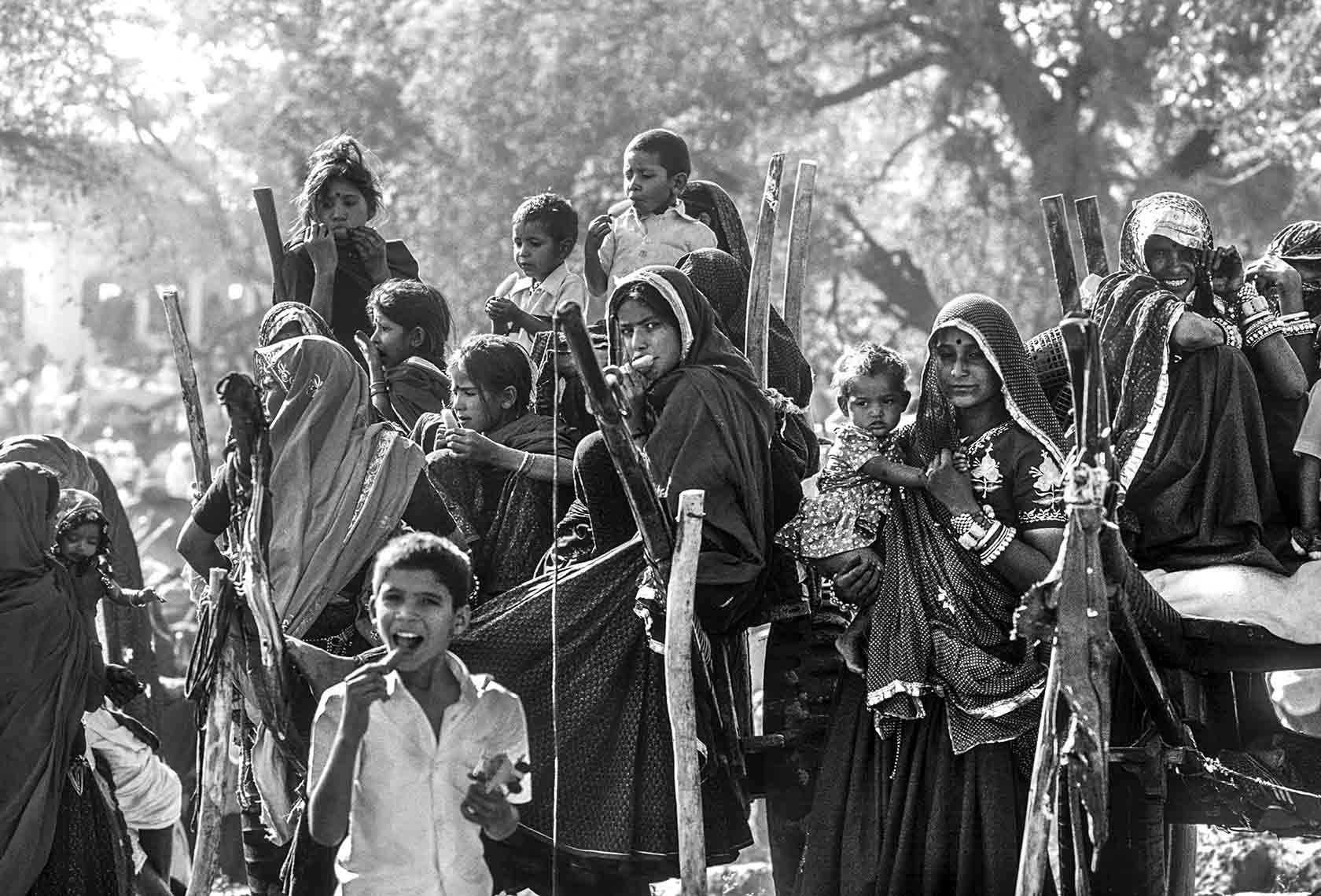 Children enjoying ice creams at a spring time fair in Rajasthan, 1986, Sudhir Kasliwal, photography