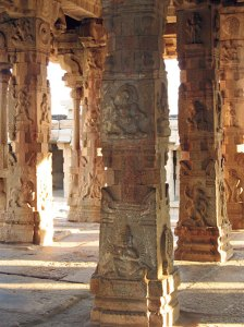 Ornately carved pillars typify the florid sculptural style of the Vijaynagar Kingdom