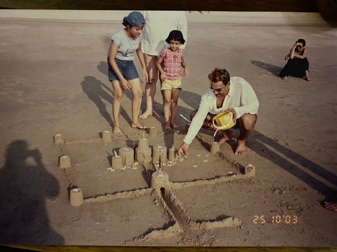 Me, my younger sister, and Wendell making sandcastles