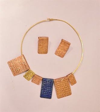Neck piece and earrings from Indigene