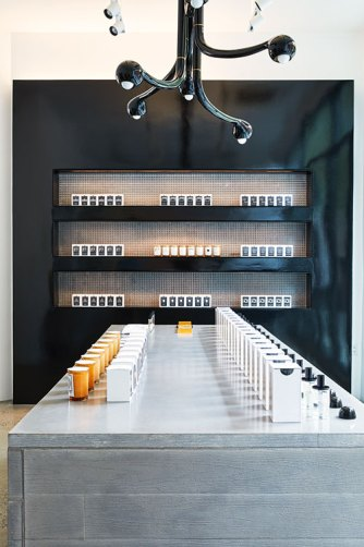 Interiors Of The Store — A Concrete table against a textured wall