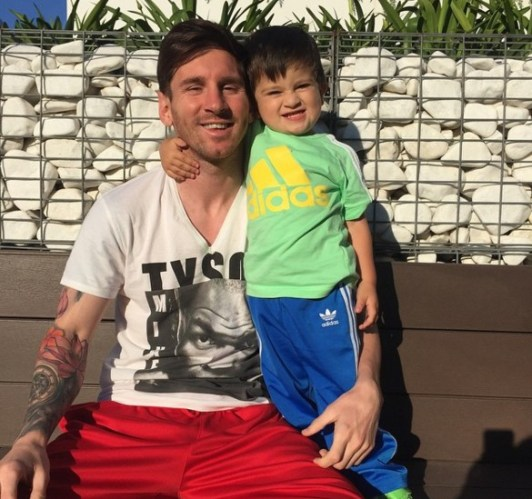 With his son Thiago Messi