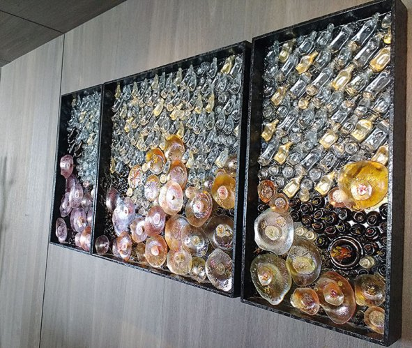 Artwork made of recycled glass bottles found on the island