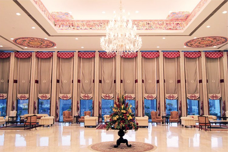 The hall in Manekshaw Centre featuring a 30-foot high ceiling and Indian art in the themes of the Mahabharata and Ramayana.