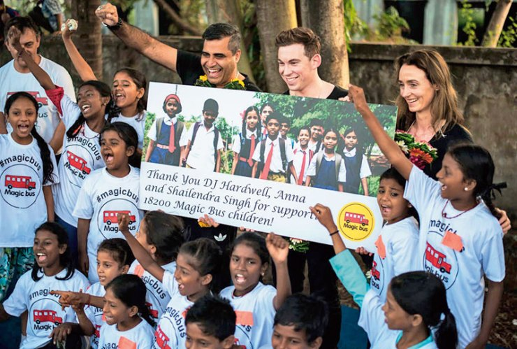 DJ Hardwell, his manager Anna Knaup and Shailendra Singh with the Magic Bus children