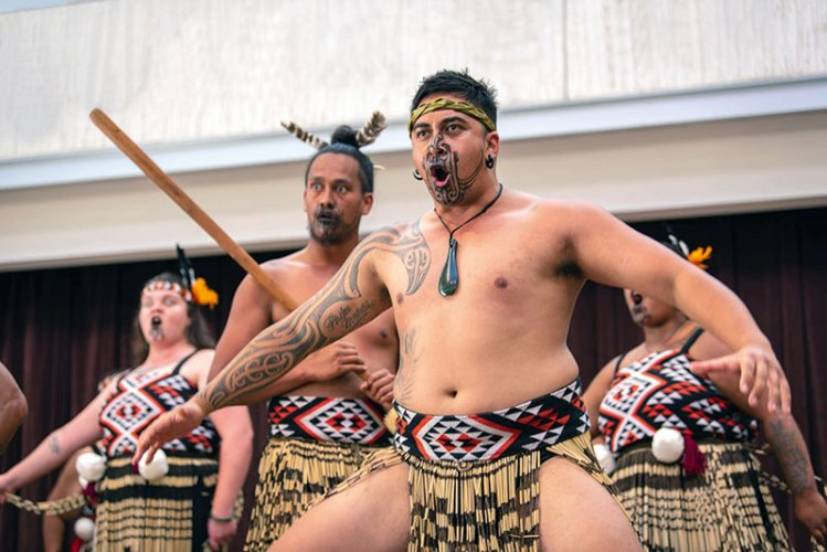 Māori warriors perform a traditional war dance