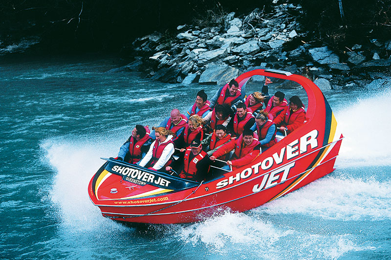 New Zealand, A Shotover Jet Whips Past Rocky Outcrops