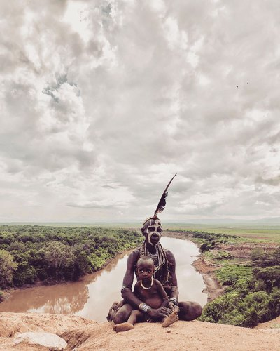 A Kara Tribe Matriarch on the Banks of the Omo River with a Child