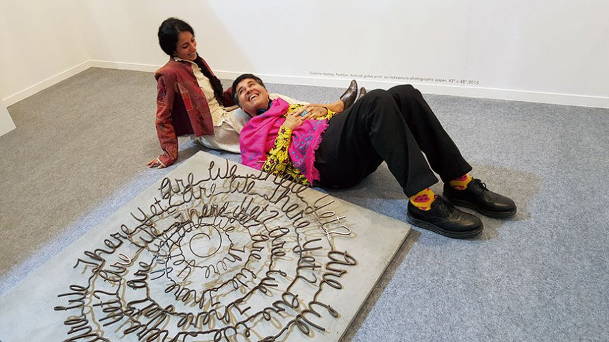 Parmesh Shahani with artist Suruchi Choksi and her sculpture at India Art Fair