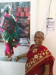 Dharavi resident Nirmala Punjabi and her Don't Touch Me sari created for the Biennale