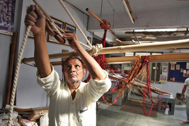 Master weaver Rohit bhai Salvi tightens the loom