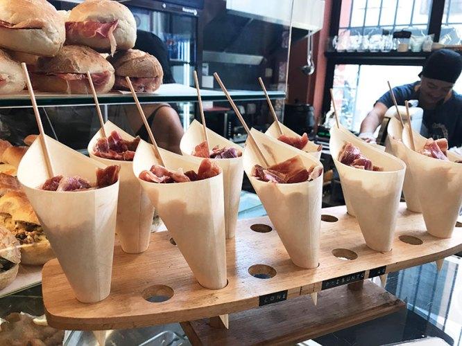 Snack of Iberian Ham in paper cones at Mercado Beira Rio