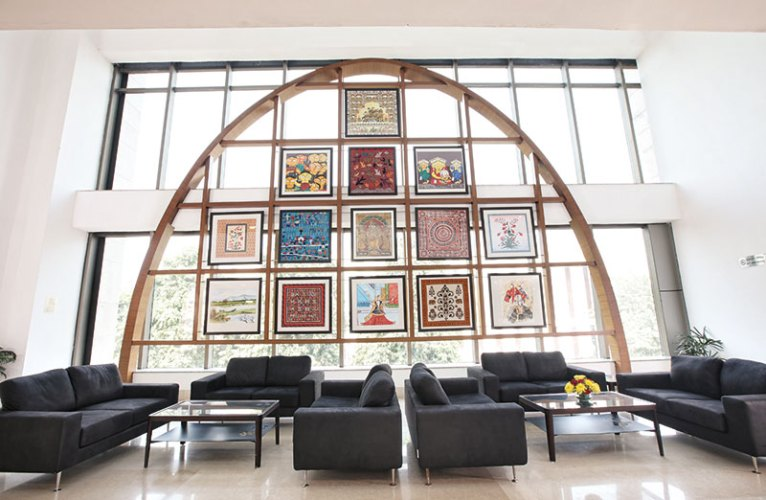 Installation of fabric art at the Pravasi Bhartiya Kendra where a huge wooden-clad steel arch adds an element of design and drama to the space.