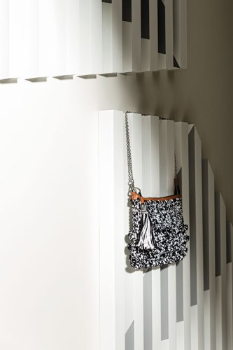 White-and-grey art installation, by Rana Begum; Black-and-white knit bag, from Missoni