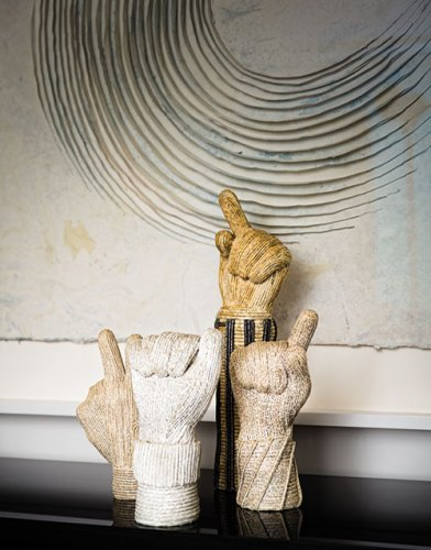 Wall art, by Guillem Nadal; hand sculptures, by Liliane Csuka