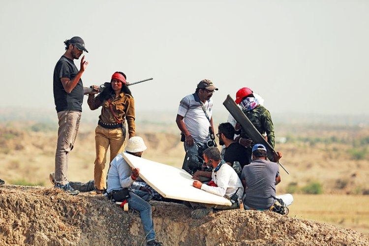 Abhishek Chaubey briefing the cast and crew before a shot