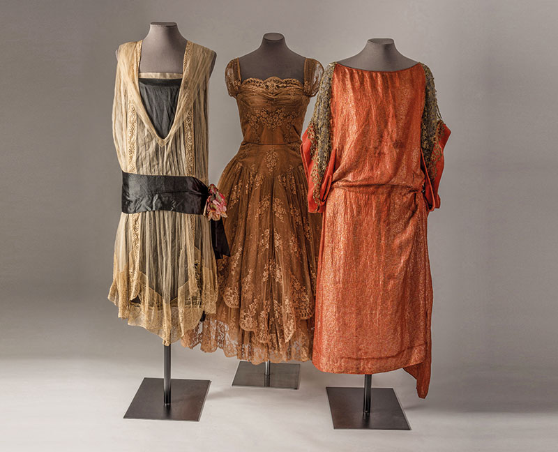 Three lace dresses comprising Raschel peach machine made lace by Callot  Soeurs  about 1926  Levers peach machine made lace by Hardy Amies  1950s   and gold  Trace the Delicate History of Lace at This UK Exhibition   Verve  . Bath Fashion Museum Gift Shop. Home Design Ideas