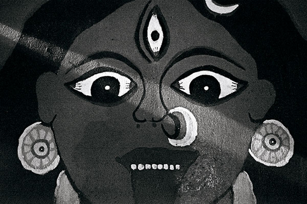 Kali. Goddess of death to some, fearsome to most, watches over me as I sit on an embankment by the Ganges.