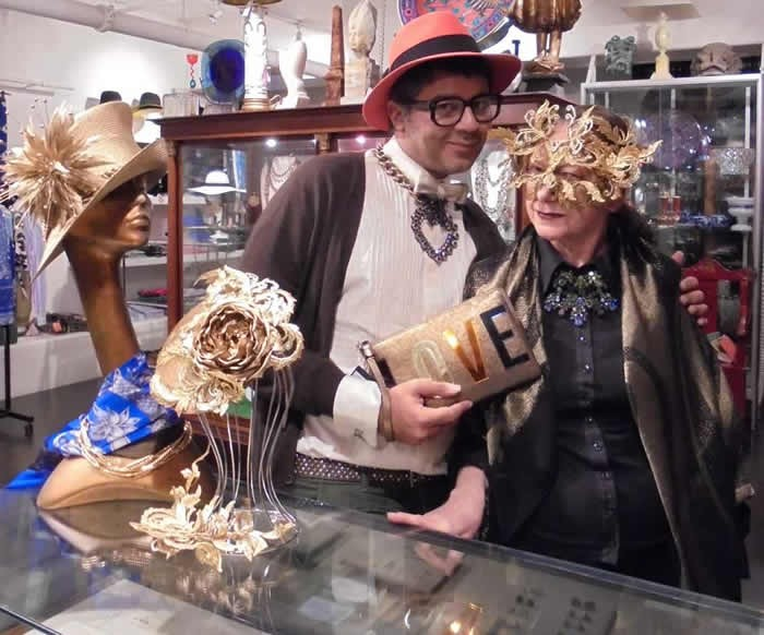 Parmesh and Christine trying out Philip Treacy hats and Lanvin accessories