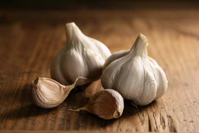 Garlic bulbs on wood