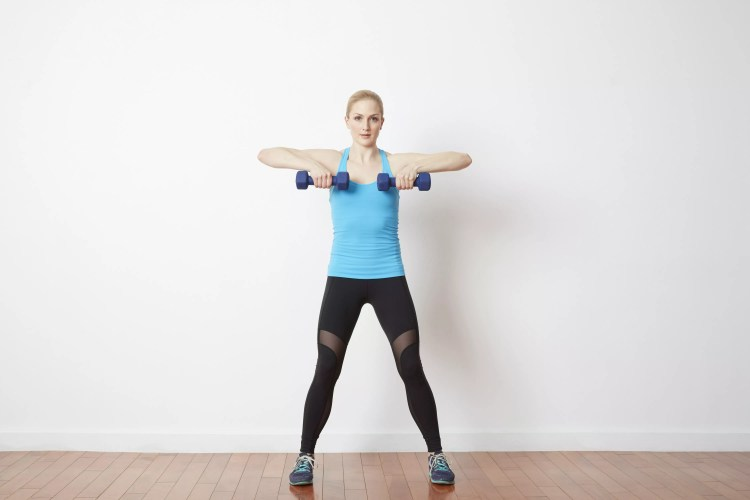 woman doing upright row