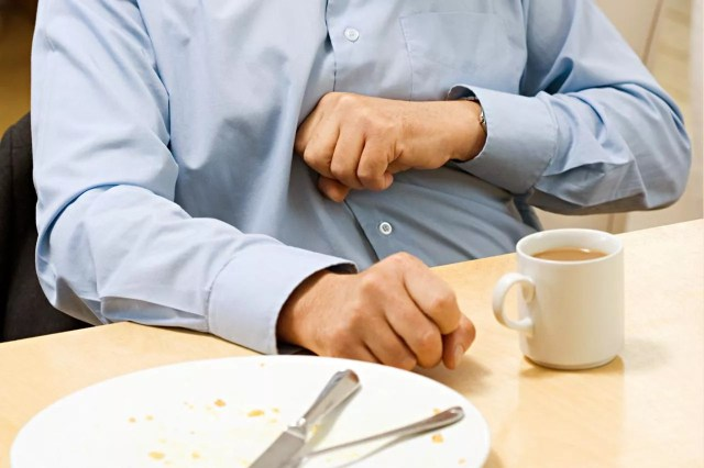 Man with indigestion