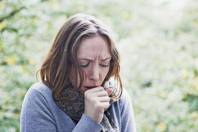 Woman coughing. France