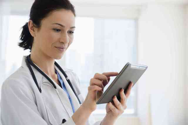 Doctor inputting info into tablet