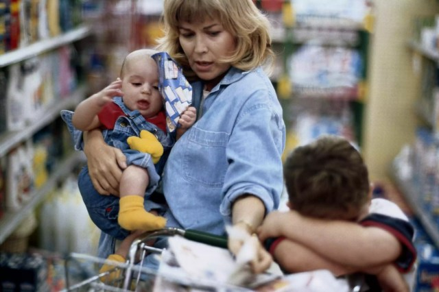 stressed mother in store