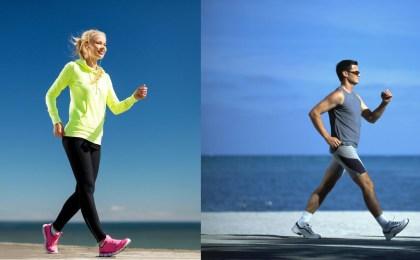 Uomo e Donna indossano scarpe da walking e praticano camminata sportiva in riva al mare