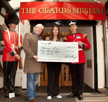 CEO Veterans Aid Dr Hugh Milroy, Lorna Hardy ( nee Cheetham) and Coldstream Guards bandsman Darren Hardy at The Guards Museum.