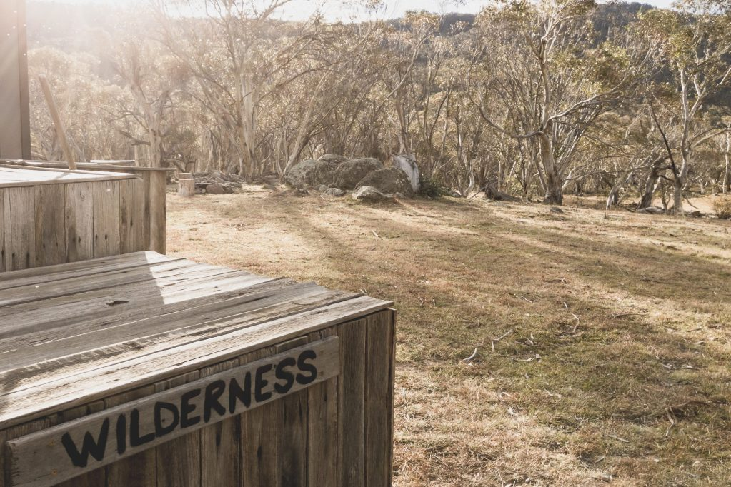 wilderness sign with bush background