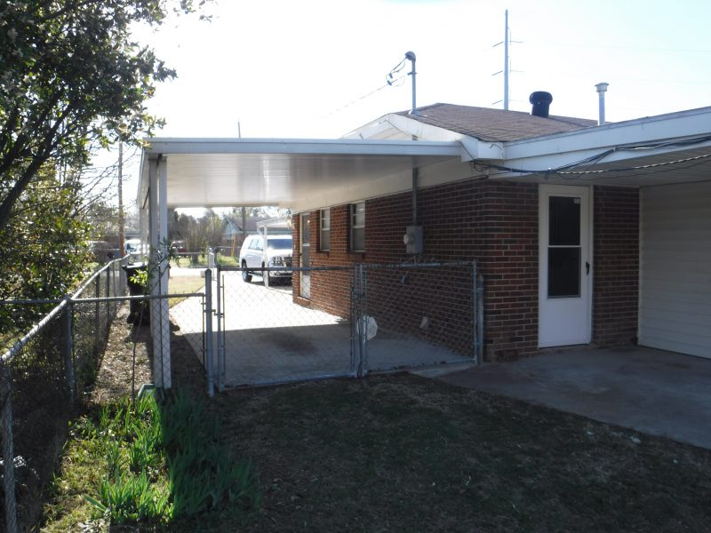 porch patio and view of one carport