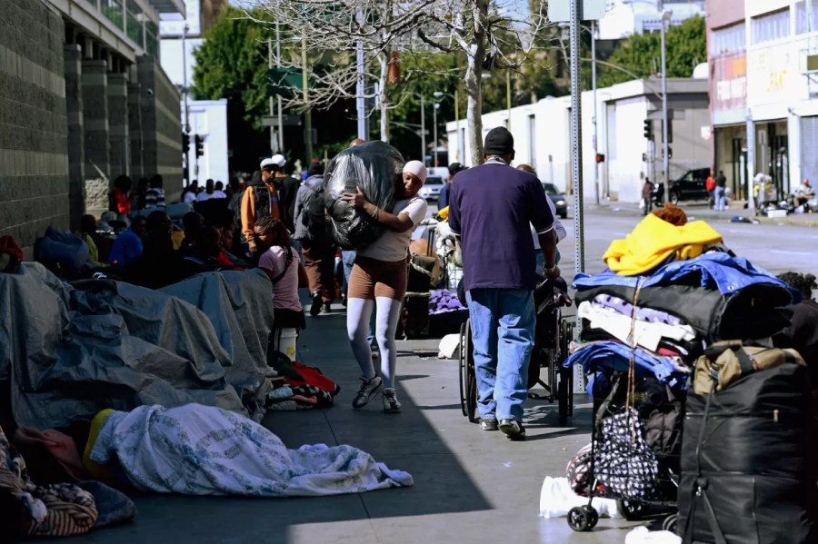 LOS ANGELES, CA - FEBRUARY 28:  Homeless people rest on a public sidewalk February 28, 2013 in downtown skid row area of Los Angeles, California.  Los Angeles officials will ask U.S. Supreme Court to overturn a lower-court ruling preventing the destruction and random seizures of belongings that homeless people leave temporarily unatteneded on public sidewalks. The lower court ruling has hindered cleanup efforts.  (Photo by Kevork Djansezian/Getty Images)