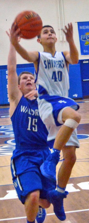 Doug Pedraza drives for two of his 13 points as Rising Sun's reserves defeated Waldron.
