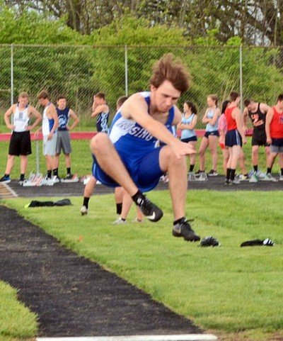 Derak Woystek flies to third place in the long jump