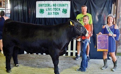 Macy Collier sold the Grand Champion steer to Garry Chandler of Chandler Chevrolet and Chandler Select for $4000. A portion of the money was pledged to the family of Derek Archer. Also pictured is Queen Summer Dickerson.  Chandler Chevrolet and Chandler Select was the Volume Buyer.