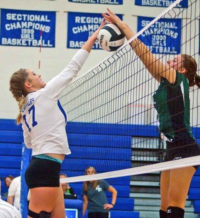 Rising Sun's Danyka Groover and South Ripley's Kiley Sparks battle at the net.