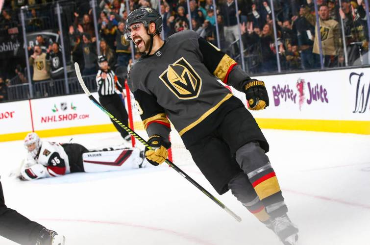 Vegas Golden Knights player Alex Tuch cheers after scoring a goal against the Arizona Coyotes at home during a Black Friday game