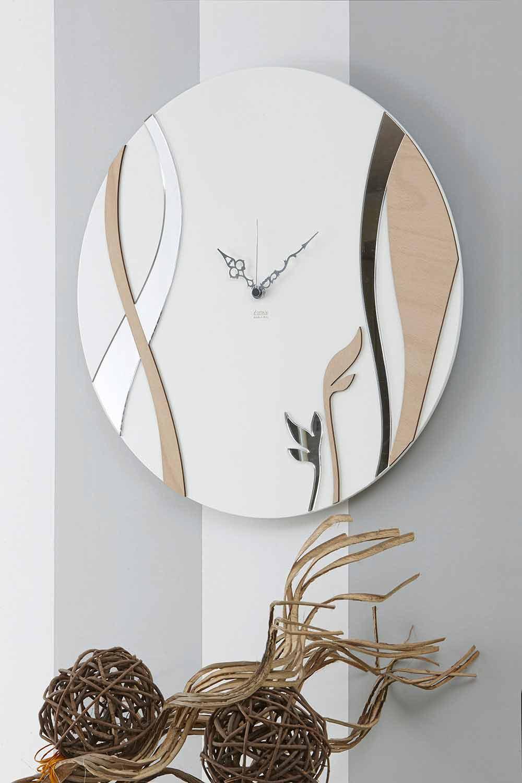 Una vasta scelta di orologi di design moderno (come quelli a forma di albero della vita) , firmati (carlo pignatelli o cuorematto) classico e contemporaneo (in vetro o porcellana) a prezzi outlet per abbellire il muro, l'ambiente e creare la giusta atmosfera alla tua casa. Orologio A Muro Moderno Di Design Rotondo In Legno Decorato