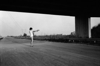 Patrick Zachmann, ITALY. Campania. Naples. 1982. Mobile anti-Camorra brigade. Officer Andrea Mormile at shoot training on an abandoned highway. A few months later on September 3rd, he will be assasinated by the Camorra.