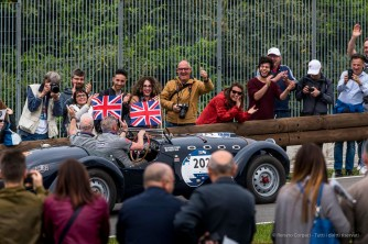 """Steven O'Leary and Robert Eels (UK) on Healey 2400 Silverstone E-Type (1959), wearing Prince Harry and Meghan Markle's masks on the day of the Royal Wedding . Nikon D750, 400 mm (80-400 mm ƒ/4.5-5.6) 1/500"""" ƒ/9 ISO 400"""