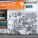 """Debido al crecimiento del turismo, algunas tiendas se convirtieron en hostales, especialmente en la calle del amor, a eso hace referencia esta """"caricatura"""""""