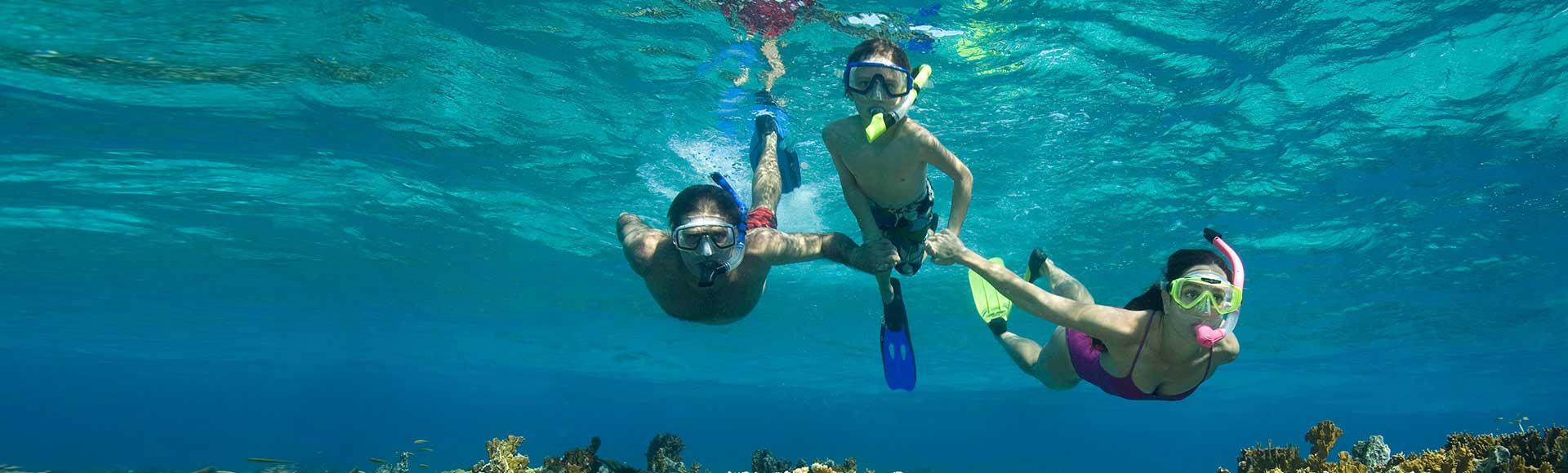 Family snorkeling in Jamaica